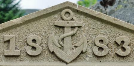 Anchors on gravestones signified an association with the sea. Rope motifs strung around stones  often accompanied an anchor as here though not shown.