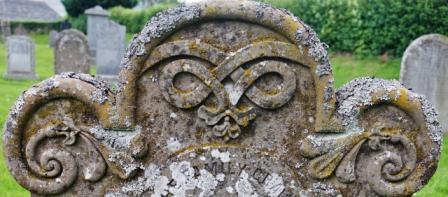 Pretty decoration on sandstone memorial stone Tullynessle