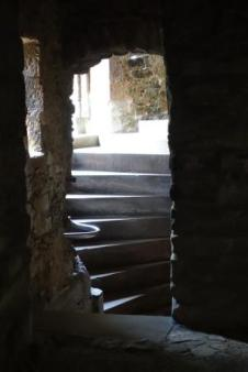 Stairs in castles were usually built to give advantage to the castle family in the case of invading swordsmen (usually right-handed) and disadvantage to their enemies